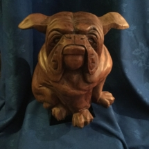 large wooden bulldog with floppy ears part of set