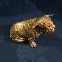 Silver over marble seated bulldog