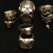 Assorted rings including sugar skull