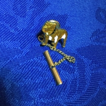 Gold enamelled mack trucks tie pin