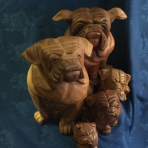 Carved wooden bulldog set