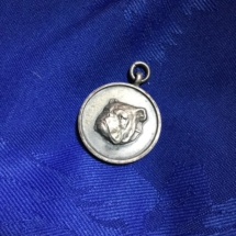 Unmarked metal bulldog medal