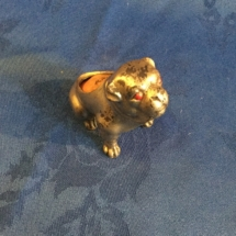 Seated bulldog pin cushion with glass eyes