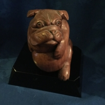 little wooden carved chubby bulldog