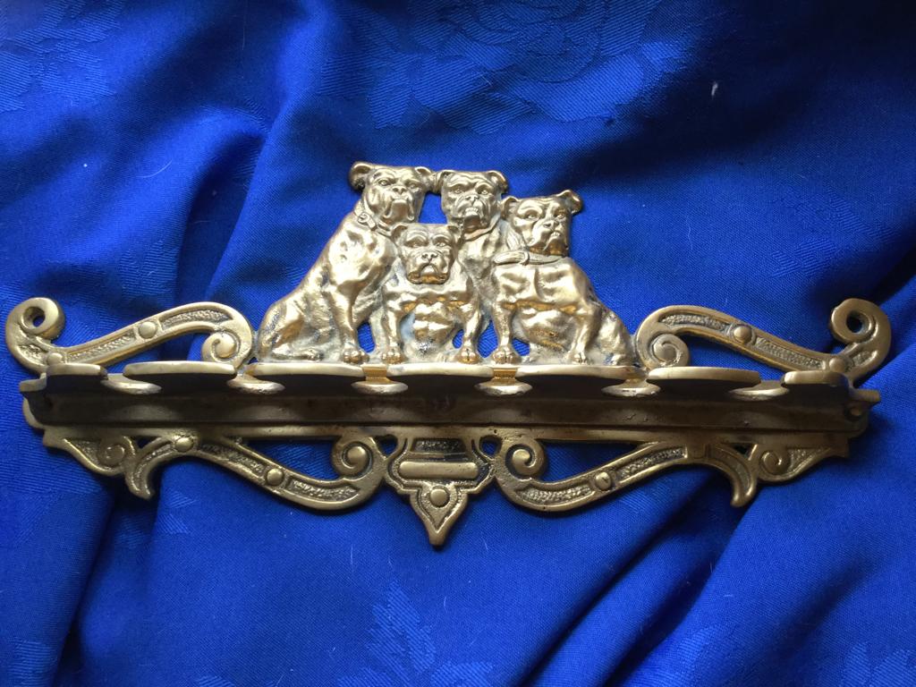 Fine antique brass pipe holder USA
