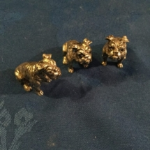 3 small metal bulldogs
